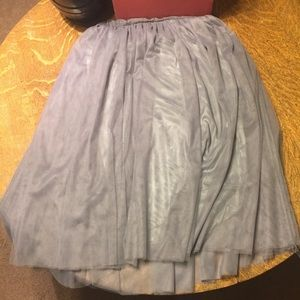 Homemade gray tool skirt.